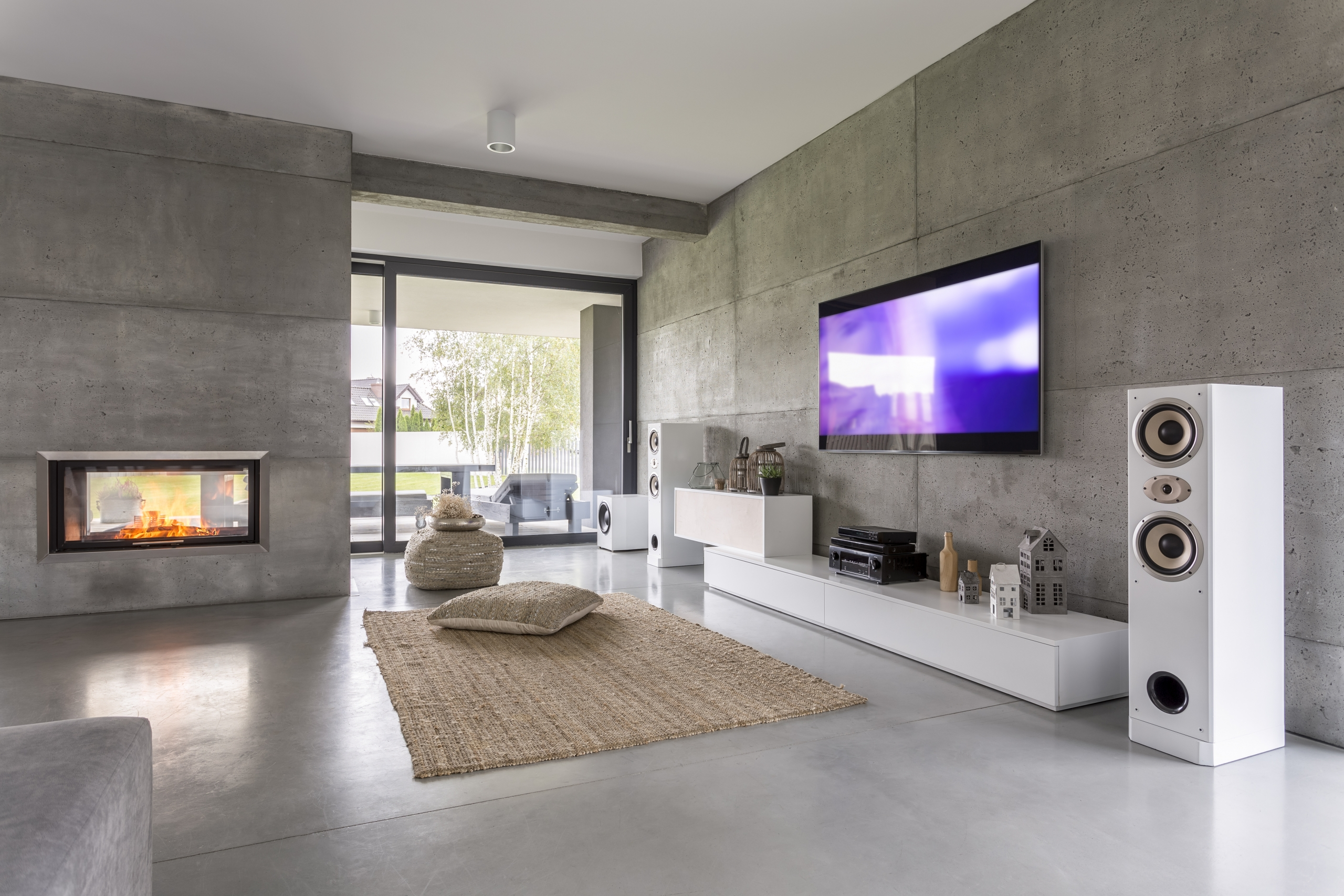 Living room with a mounted television and surround sound speakers setup
